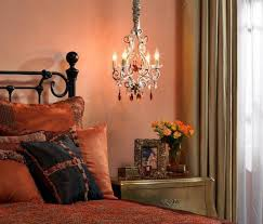 Small Chandeliers For Bedrooms by Yellow Warm Bedroom Colors With Floral Bedding Cozy Warm Bedroom