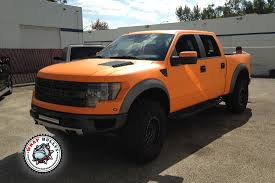 truck ford raptor ford raptor svt wrapped in 3m matte orange truck wrap wrap bullys