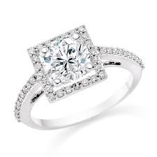 white gold engagement rings uk cut 0 82 carat halo engagement ring with side stones 18k