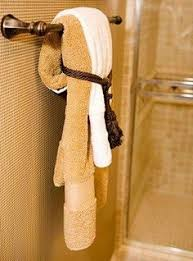 bathroom towel folding ideas ways to decorate the towel racks in your bathroom upstairs