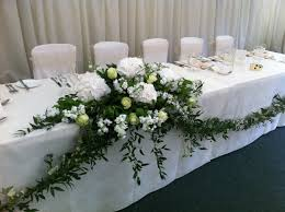 top table arrangement and foliage garland but perhaps with some