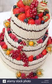 european wedding cake made of white chocolate and berries stock