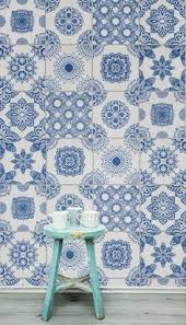 Wallpaper Nautical Theme - add salvaged bits of vintage wallpaper to stair steps in a cottage