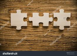 three 3 wooden pieces jigsaw puzzle stock photo 667920235