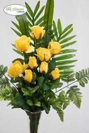 artificial silk yellow roses arrangement in glass vase