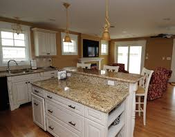 granite countertop white cabinets with oak trim sea glass tiles