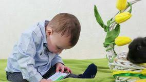 easter plays for children baby crawling on green floor kid with bunnies