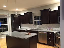 Dark Cabinet Kitchen Designs by Flooring Grey Azul Platino Granite With Pendant Lighting Also