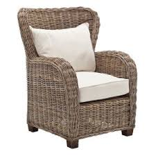 siege en rotin fauteuil en rotin dossier arrondi avec coussins royan