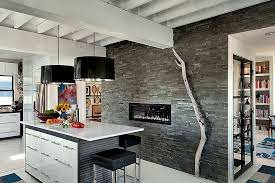 view in gallery modern rustic kitchen with fireplace and striking pendant lights from patty kennedy interiors