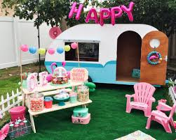 kitschy camper trailer birthday party flamingo decor retro