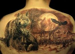 lovely wolves and wildlife tattoo on back representing family love