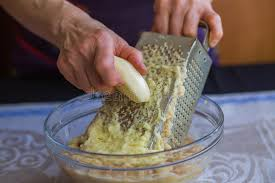 potato pancake grater potatoes shredded on a grater stock image image of hash
