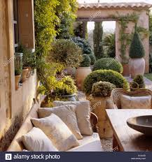 villa terrace with bench and terracotta pots mallorca stock photo