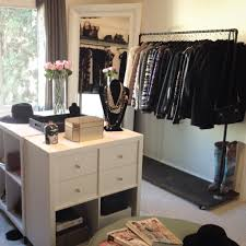 closet island with drawers and bench