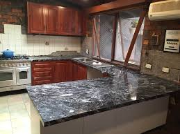 granite countertop white kitchen cabinets backsplash ideas red