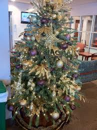 purple and gold christmas tree unac co