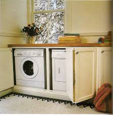 laundry room base cabinets washer and dryer behind base cabinet doors home laundry