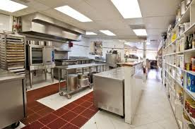 immaculate hands on state of the art commercial kitchen picture