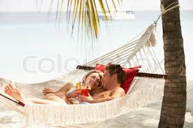 romantic couple relaxing in beach hammock stock photo colourbox