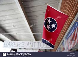 Tennesse Flag Tennessee Flag Hanging Outside A Store Under Covered Walkway In