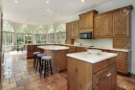 kitchen with two islands large kitchen with two islands in luxury home stock photo picture