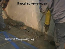 a saw cut then jack hammer to break out the concrete where