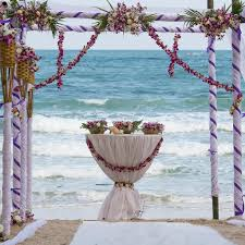 wedding arch decorated with on tropical sand