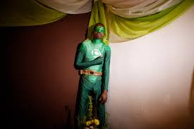 puerto rican dressed like green lantern at his wake bossip