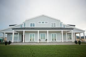 amazing veranda with white pillars and great soft grey wall facade