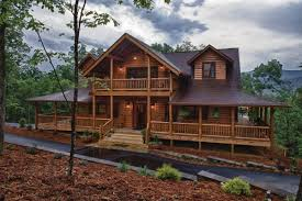 dazzling log cabin homes with wrap around porches using wooden