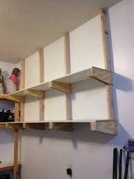 Wooden Wall Shelf Designs by Garage Shelves To Keep Your Small Appliances Small Statue