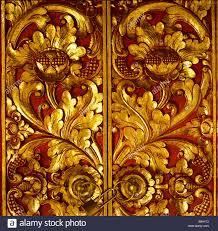 wood carving door entrance gold leaf detail padlock denpasar