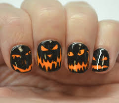 halloween howtos nail art her campus 10 halloween nail art ideas