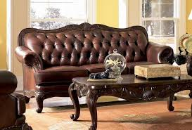 traditional sofas with wood trim attractive wood and leather sofa victoria traditional button within