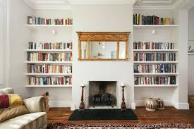 bespoke shelves built on both sides of the fireplace by empatika