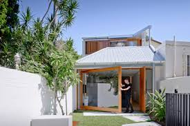 design a house a house that goes modern behind its traditional facade design milk