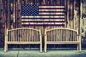Rustic Log Benches - rustic log benches with usa flag retro stock photo image 52385265