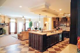 the lux experience at greg tilley s greg tilley modular homes the living room and kitchen in the lux modular home