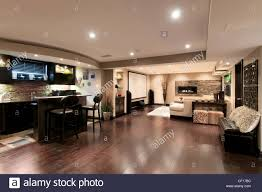home theater basement basement in luxury residential home with bar and home theater