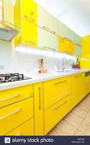 modern kitchen design yellow modern design kitchen with yellow and green elements stock