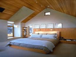 White Single Sleigh Bed Small Attic Bedroom Flower Patterned White Blanket Black Wooden