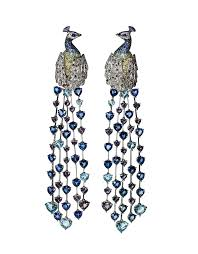 peacock earrings chopard animal world an immortal peacock earrings featuring