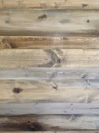 reclaimed wood vs new wood wood feature walls new pine planks stained to look like salvaged