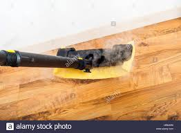 Laminate Floors Cleaning Wooden Parquet Laminate Floors Cleaning With Steam In The Room