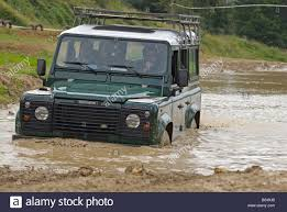 land rover track land rover crossing through a flooded dirt track in bining france