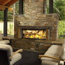 luxury outdoor chat area massive stone faced outdoor gas fireplace