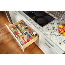 keep spices conveniently stored in a drawer by the stove with rev