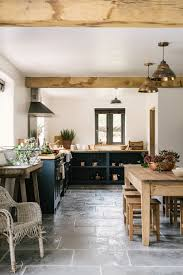 Grey Wood Floors Kitchen by A Stylish Country Kitchen By Devol With Worn Grey Limestone