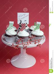 christmas decorated chocolate red velvet cupcakes vertical